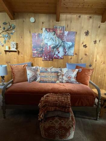 daybed and wolf painting