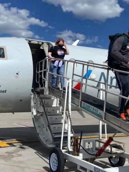 Leah coming down ramp off plane to Flagstaff, Arizona airport