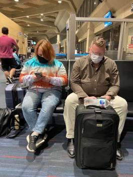 Leah & Ray at the Kansas City, MO, airport in their masks