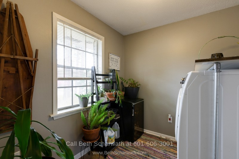 Real Estate Properties for Sale in Hattiesburg MS - This Hattiesburg MS home for sale boasts a large laundry room, perfect for your needs.