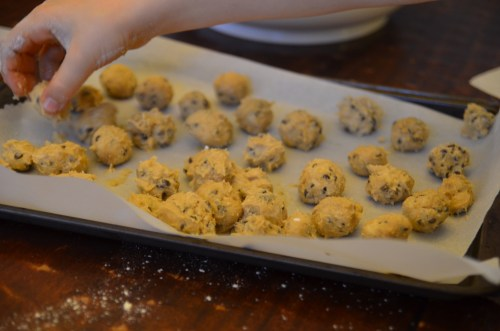 cookie dough truffles ready to be chilled in the freezer before dipping
