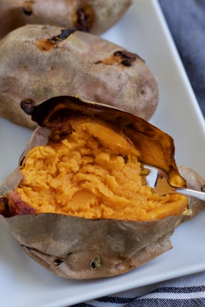 gorgeous orange baked sweet potato mashed right in the skin