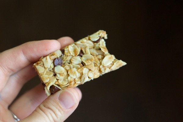a bite of a chewy chocolate chip granola bar