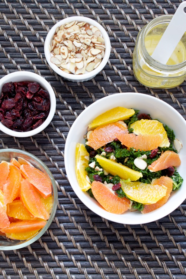 Citrus kale salad is full of delicious contrasts - tangy dressing, hearty kale, sweet juicy oranges, and crunchy almonds. It's salad heaven, and you can make prep the components ahead of time for salad all week!