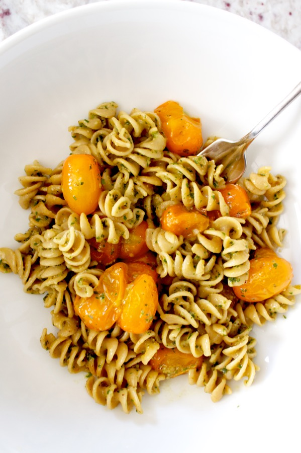 Quick and full of summer flavor, pesto pasta with burst tomatoes is easy and delicious.