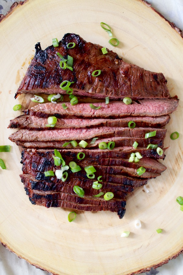 Soy sauce and honey marinated flank steak is simple, juicy, and flavorful thanks to hints of garlic and ginger.
