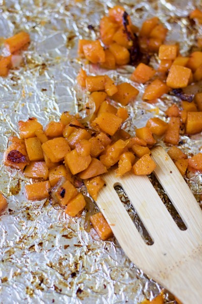 roasted butternut squash with onions close-up
