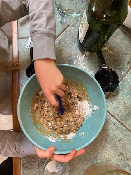 stirring apple cinnamon raisin christmas bread