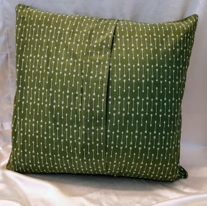 back of green cushion cover with atheist quotes