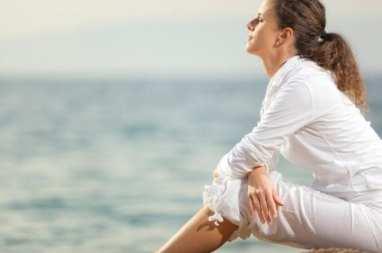 woman-calmly-looking-at-ocean