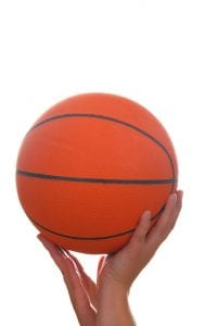 Hand and basketball ball isolated on white