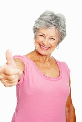 Confident senior woman giving you a thumbs up on white background