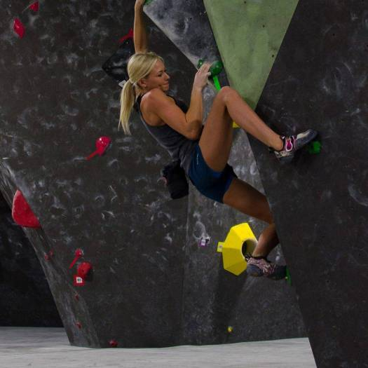 black rock bouldering gym image with woman