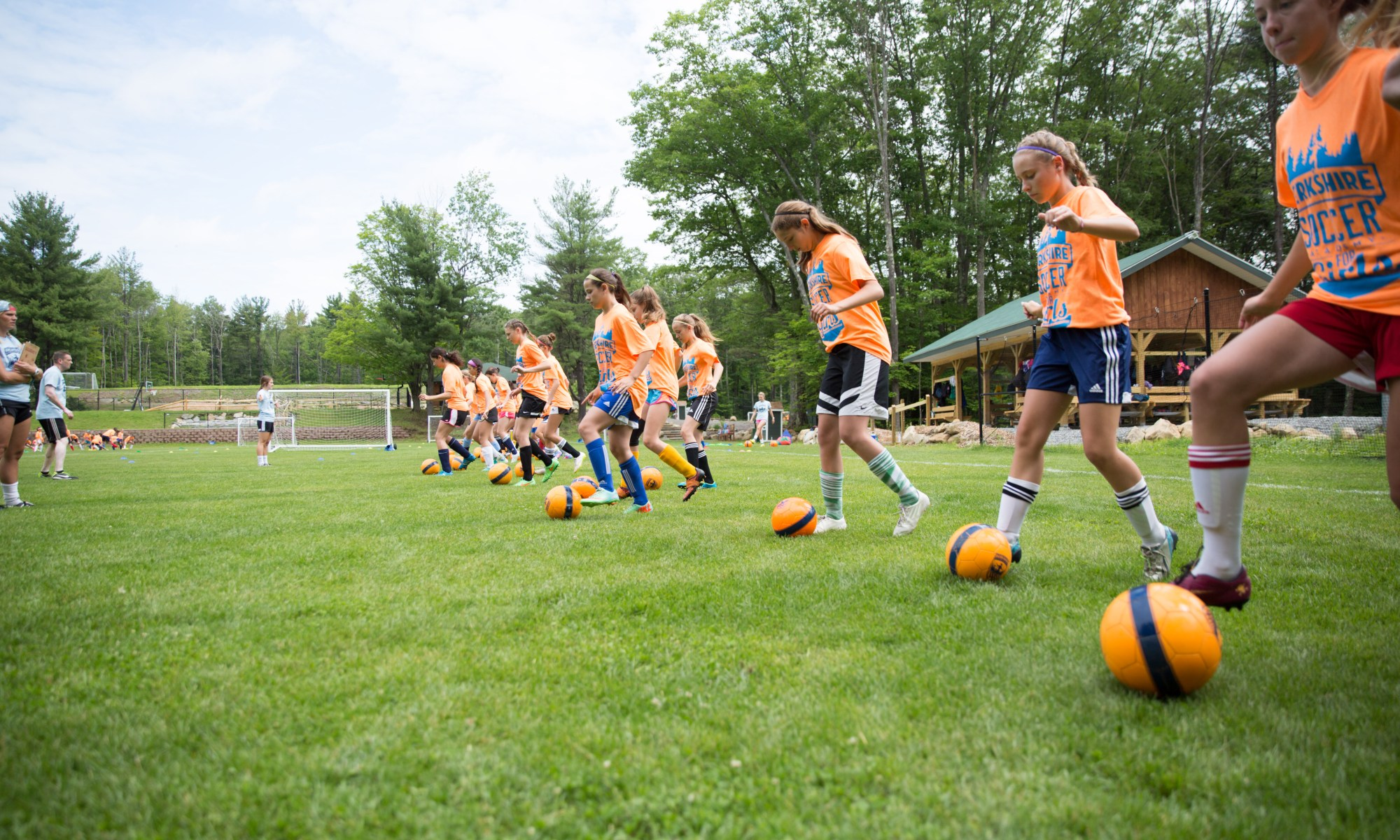 berkshire girls playing soccer at summer camp