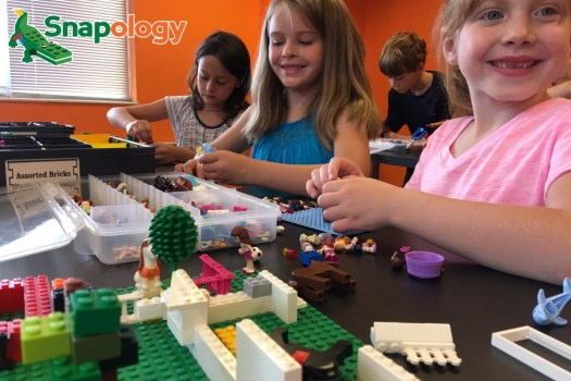 3 Girls building with blocks
