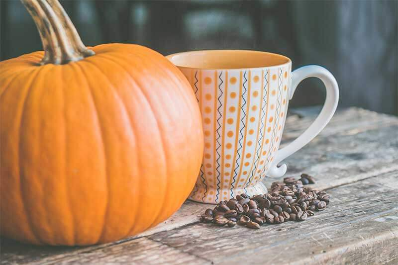 pumpkin with coffee cup