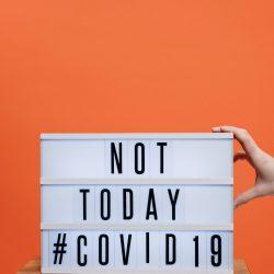COVID19 sign on orange background