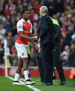 LONDON, ENGLAND - APRIL 2: Arsenal manager Arsene Wenger shakes hands with Alex Iwobi after his substitution during the Barclays Premier League match between Arsenal and Watford at Emirates Stadium on April 2, 2016 in London, England. (Photo by Stuart MacFarlane/Arsenal FC via Getty Images)
