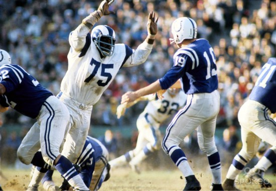 """Like Lawrence Taylor would do twenty years later for the outside linebacker position, Jones revolutionized the role of the defensive end with his groundbreaking ability to tackle the quarterback behind the line of scrimmage and even coined the term, """"sack."""" No one knows how many """"sacks"""" this HOF'er had, as the NFL did not keep official sack records until 1982. Played for the Rams, Chargers and Redskins from 1961 to 1974. Dabbled in acting following his retirement; died at age 74."""