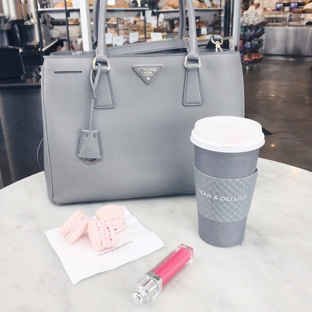 prada bag and macarons between two coasts
