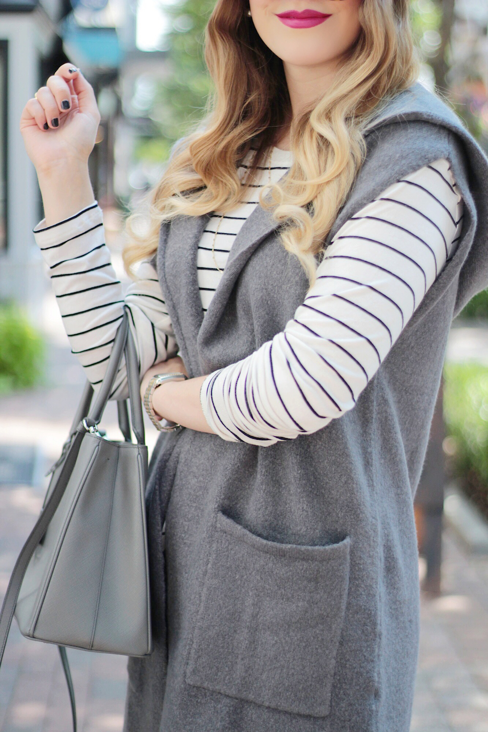 the sleeveless sweater that every girl needs