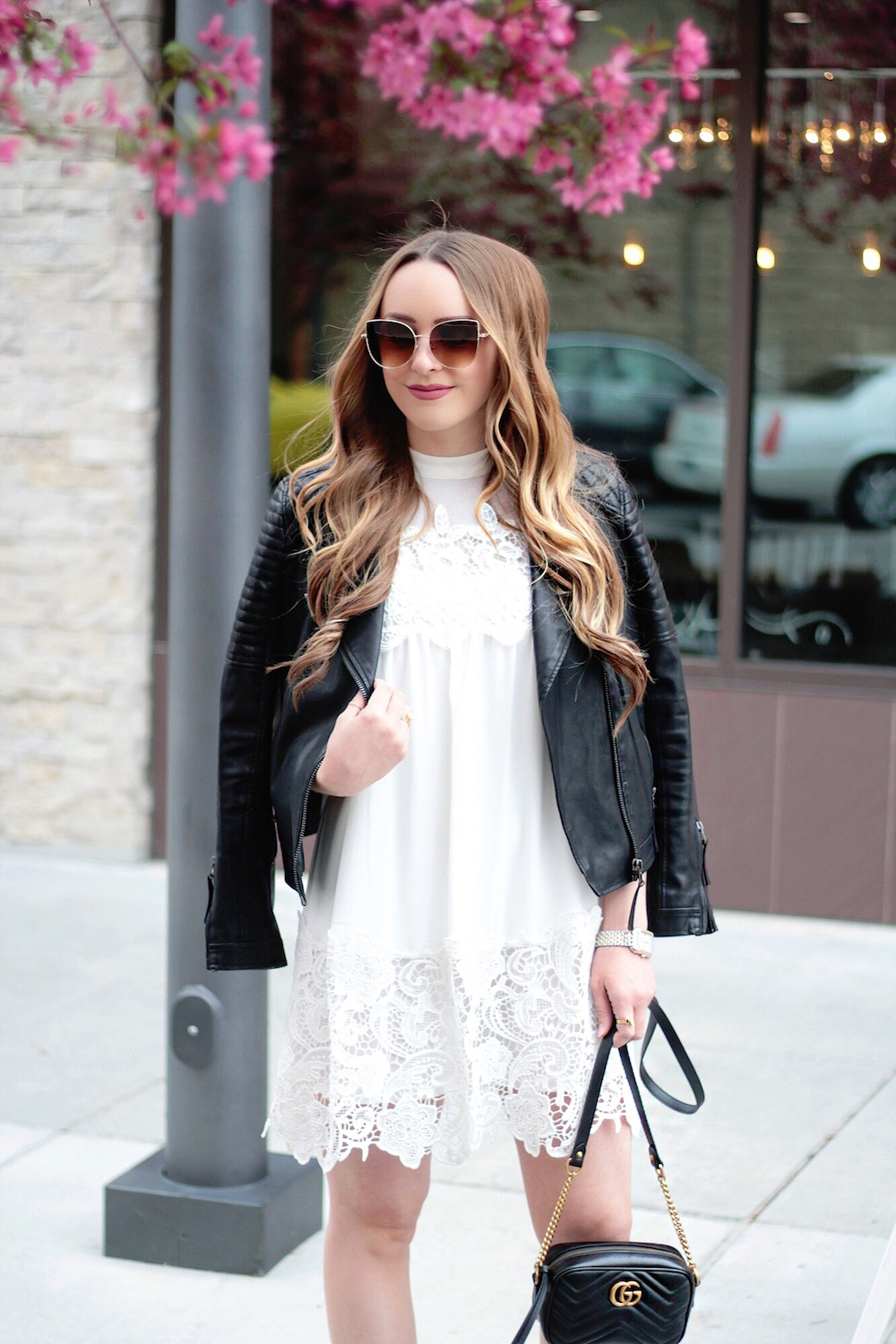 white dress and moto jacket rachel puccetti between two coasts