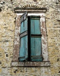A window torn by time, left unrepaired as the town became abandoned.
