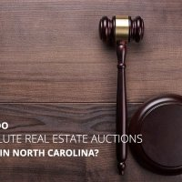How Do Absolute Real Estate Auctions Work, and What Can I Expect at 98 Raven Cliff Lane?