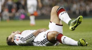 Germany's Mario Goetze sits on the floor after a foul during the Euro 2016 group D qualifying soccer match between Ireland and Germany in Dublin, Ireland, Saturday, Jan. 13, 2001. (AP Photo/Peter Morrison) The Associated Press