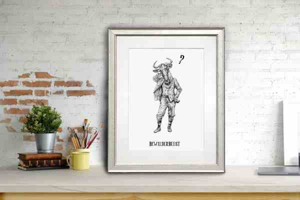 Print of a wildebeest dressed in human clothing in a white frame sitting on a shelf learning against a white brick wall