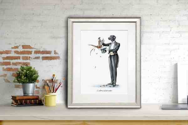 Print of a Black Labrador in a magician's outfit pulling a pheasant out a hat in a white frame leaning against a brick wall