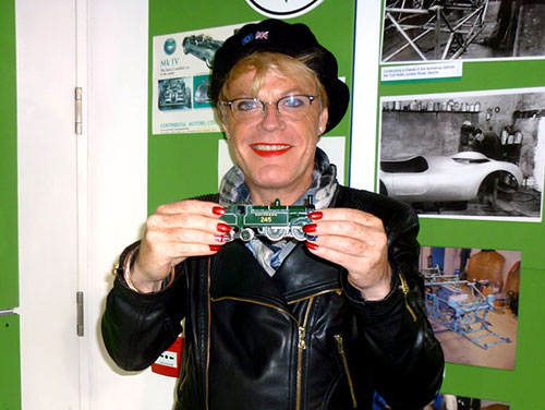 Eddie Izzard holding a model train