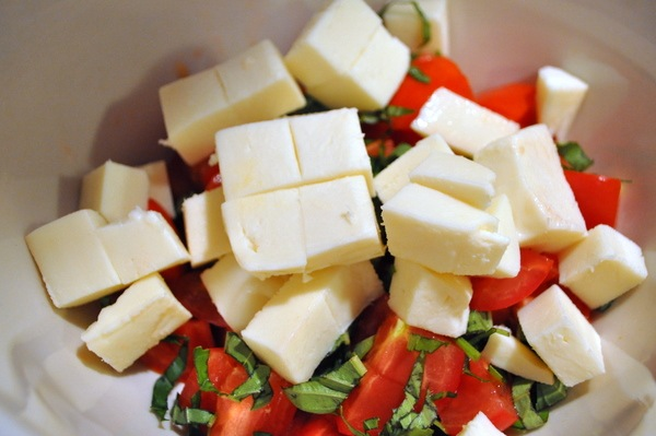 Fresh tomatoes out of the garden with fresh basil and mozzarella make the simplest and easiest caprese salad recipe.
