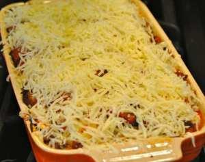 Cheese topped ravioli lasagna