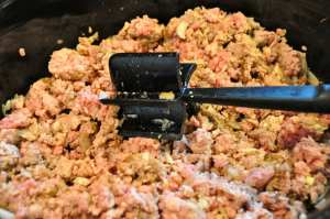 breaking up ground meat with a mix and chop