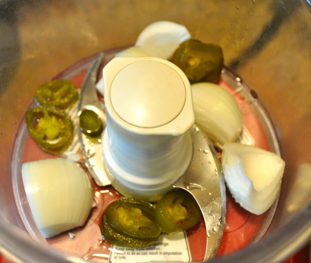 Jalapenos and onions in a food processor