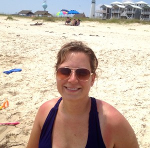 wearing aviator sunglasses on the beach