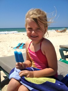 eating popsicles on the beach