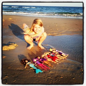 Playing with Barbies on the beach