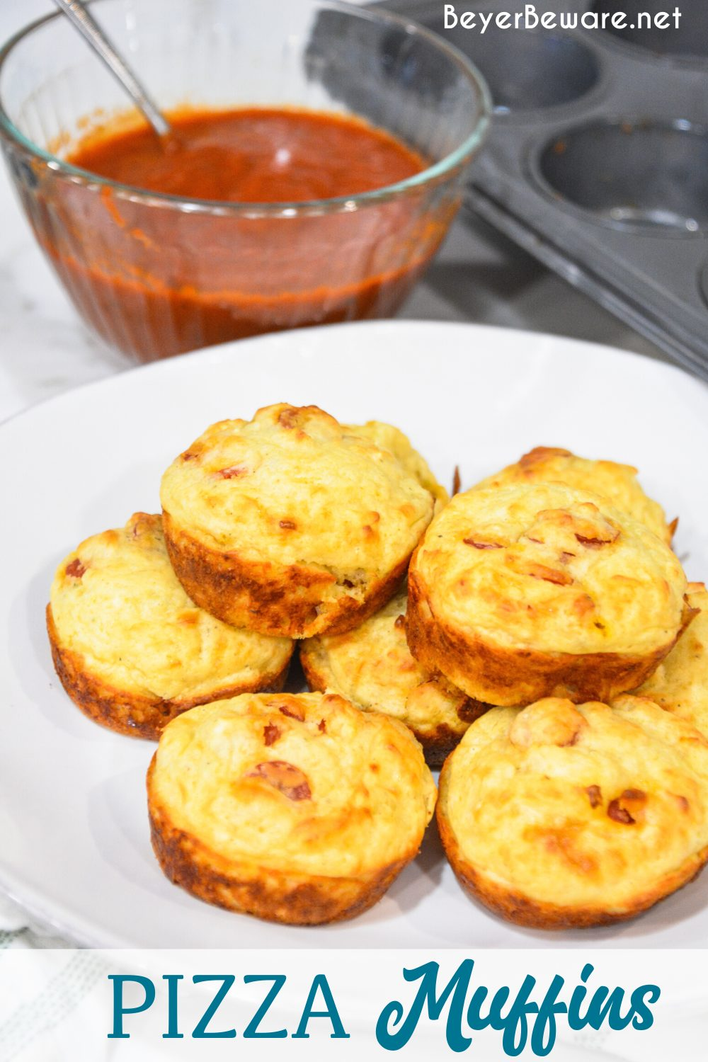 Pepperoni pizza muffins is a simple recipe made with lots of biscuit mix, pepperoni and cheese are a great lunch, dinner on the go or even pizza snack.