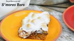 S'mores bars are an easy fall treat for the s'mores lovers. Five simple ingredients and less than 30 minutes makes the perfect pitch-in dessert. #smores #5ingredientsorless #Bakingrecipes