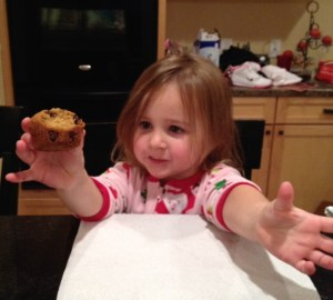 Miss A eating a warm muffin