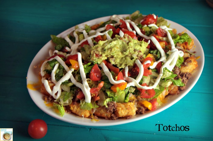 Totchos Platter -Tater Tots topped with traditional nacho toppings. Awesome switch up for a quick weeknight meal.