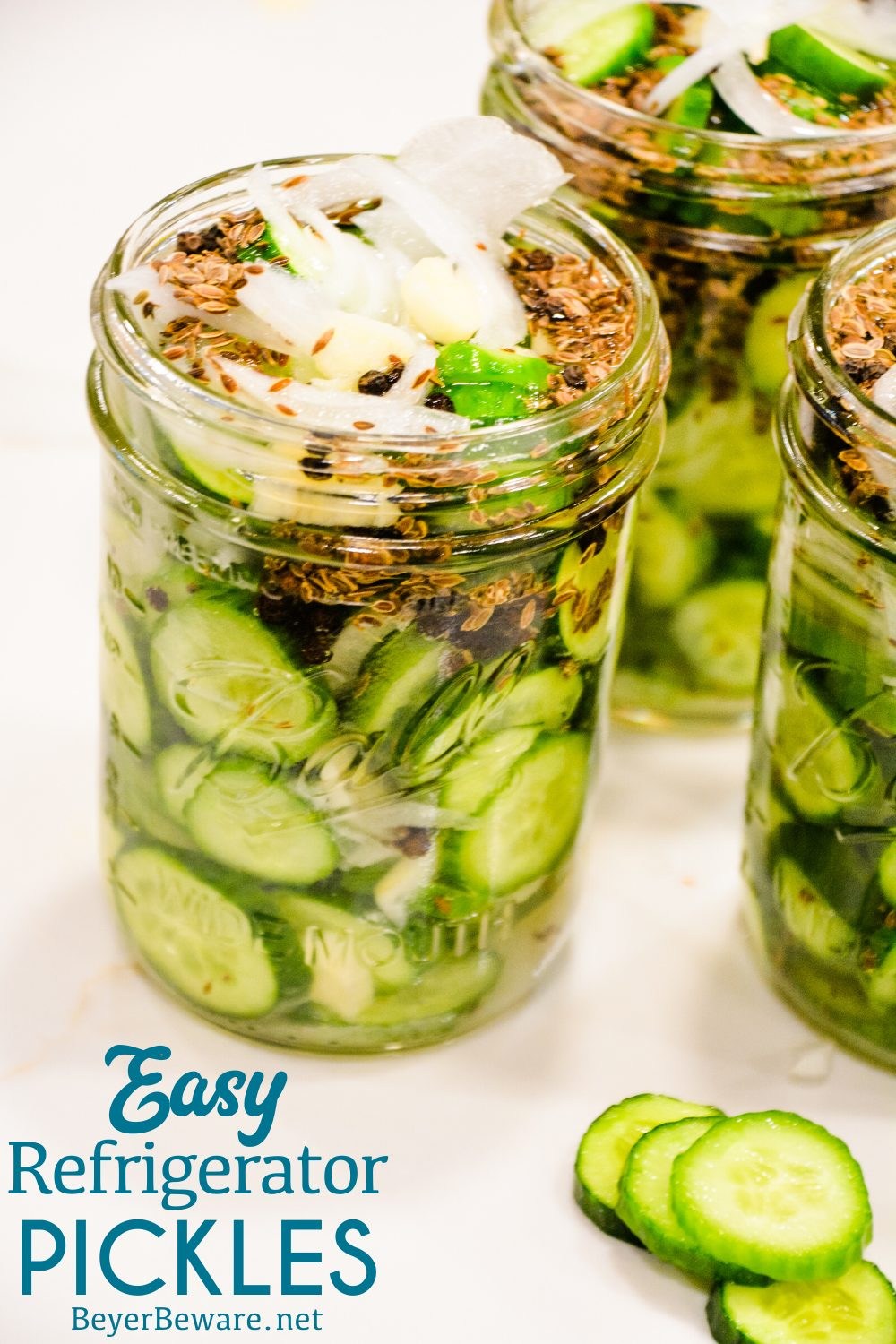 These easy refrigerator dill pickles are quick to make refrigerator pickle recipe made with cucumbers, onions, garlic, and lots of seasonings for the ultimate homemade pickles.