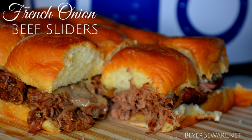 Everything you love about french onion soup is wrapped up in between Hawaiian rolls with this crock pot French Onion Beef Slider recipe.
