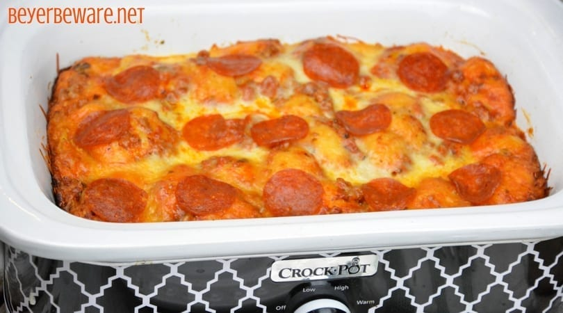 Crock pot bubble up pizza casserole is an easy bubble pizza casserole made with grands biscuits, spaghetti sauce, and your favorite pizza toppings.