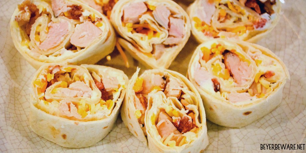Chicken bacon ranch roll-ups are quick tortilla wrapped sandwich recipe filled with ranch flavored cream cheese, cubed chicken, bacon, and cheese and sliced into pinwheels.