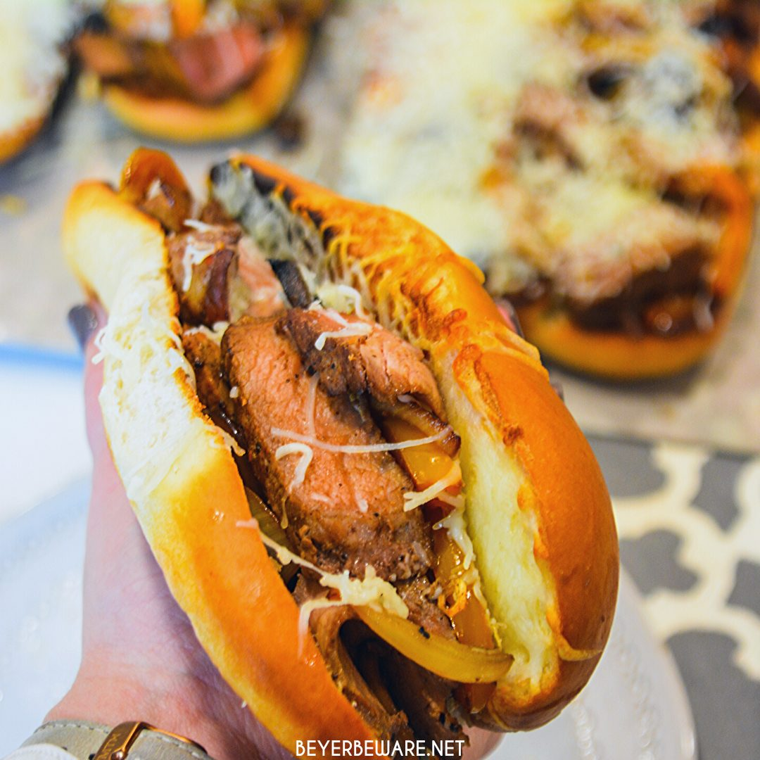 Leftover steak sandwiches use up cooked steaks to create a midwest version of a Philly Cheesesteak sandwich with caramelized mushrooms, onions, and peppers.