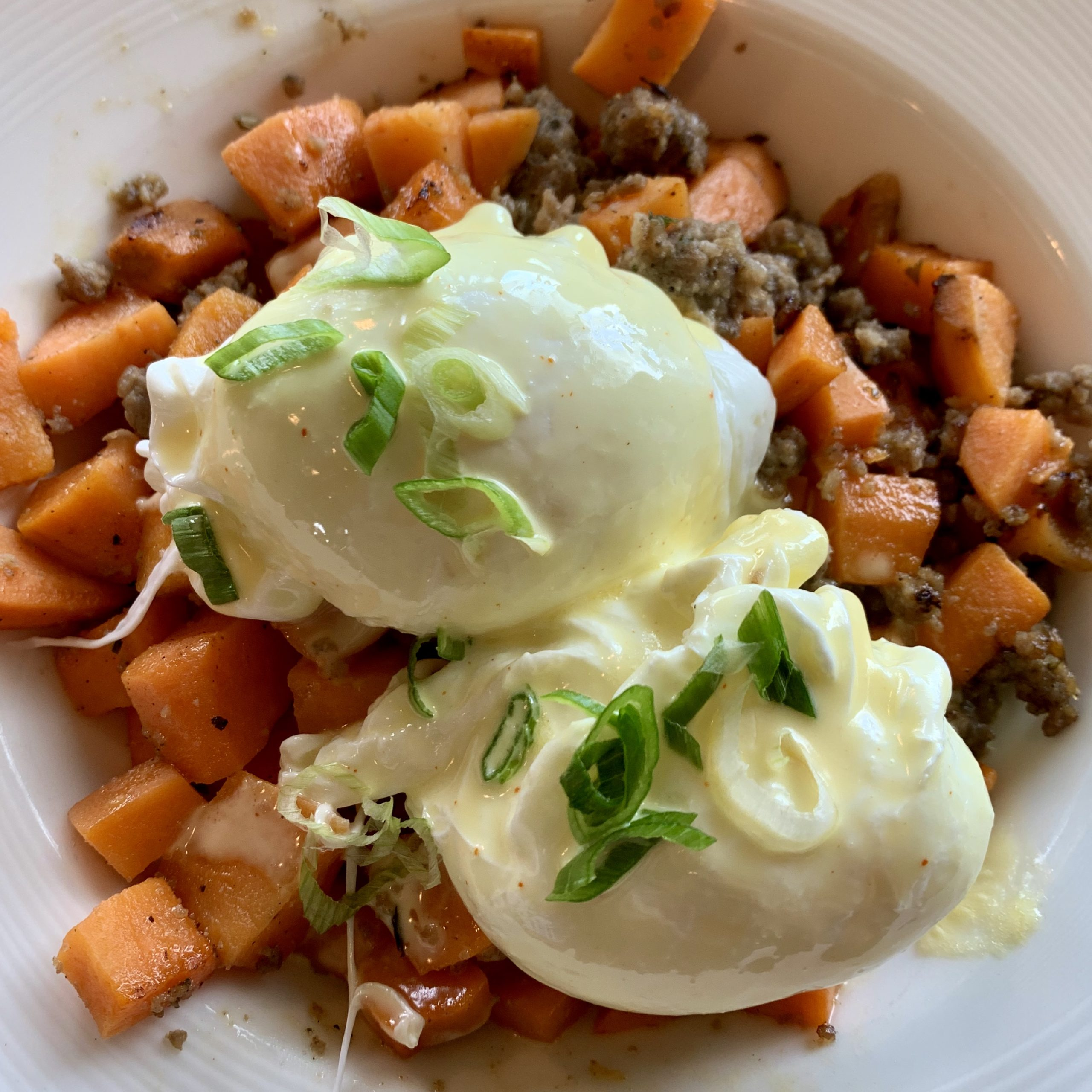 Sweet Potato Hash with sausage and eggs is a meal I had while on a girl's weekend up in Petosky, Michigan last fall.
