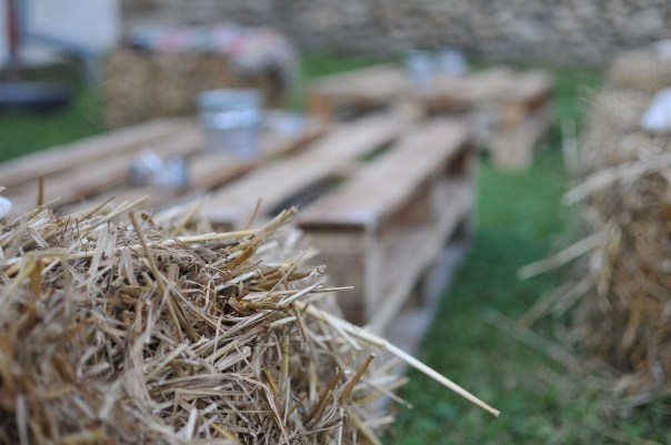 Hay stacks and wooden pallets for the outside area